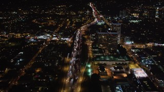 LD01_0049 - 5K stock footage aerial video following the 405 at night through West Los Angeles, California