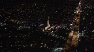 LD01_0050 - 5K stock footage aerial video tilt to reveal the Los Angeles California Temple, Westwood, California, at night
