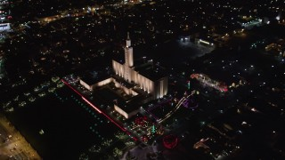LD01_0052 - 5K aerial stock footage video of an orbit of Los Angeles California Temple, Westwood, California, at night