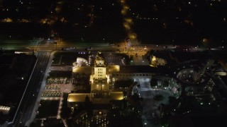 LD01_0059 - 5K stock footage aerial video orbit Beverly Hills Police Department at night, California