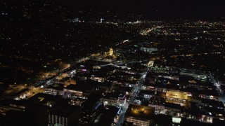 LD01_0060 - 5K stock footage aerial video flying toward the Beverly Hills Police Department at night, California