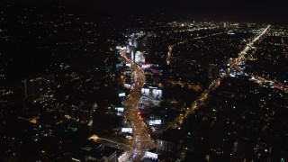 LD01_0062 - 5K stock footage aerial video following the Sunset Strip at night in West Hollywood, California
