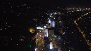 LD01_0063 - 5K stock footage aerial video fly over the Sunset Strip at night, West Hollywood, California