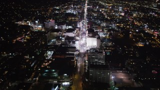 LD01_0070 - 5K stock footage aerial video approach hotels and theaters at night in Hollywood, California