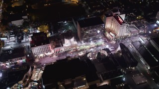 LD01_0071 - 5K stock footage aerial video flyby hotels and theaters at night in Hollywood, California