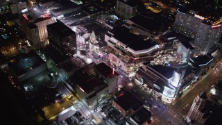 LD01_0072 - 5K stock footage aerial video of mall, theaters and hotels at night in Hollywood, California
