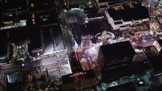 LD01_0073 - 5K stock footage aerial video of Grauman's Chinese and Kodak Theaters at night in Hollywood, California