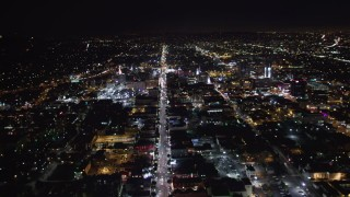 LD01_0074 - 5K stock footage aerial video tilt from hotels and theaters up Hollywood Boulevard at night, Hollywood, California