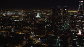 LD01_0075 - 5K stock footage aerial video of city hall, and reveal skyscrapers at night in Downtown Los Angeles, California