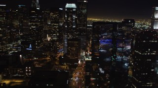 LD01_0076 - 5K stock footage aerial video pan across Downtown Los Angeles, California skyscrapers at night
