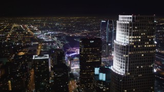 LD01_0080 - 5K stock footage aerial video fly over skyscrapers to approach Staples Center at night Downtown Los Angeles, California