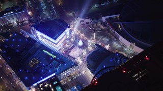 LD01_0081 - 5K stock footage aerial video ice skating and fair at Nokia Theater at night Downtown Los Angeles, California