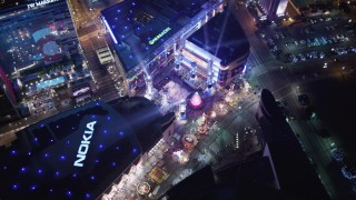 LD01_0082 - 5K stock footage aerial video orbit ice skating at Nokia Theater, and tilt to hotels at night Downtown Los Angeles, California