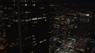 LD01_0085 - 5K stock footage aerial video flyby skyscrapers to reveal city hall at night Downtown Los Angeles, California