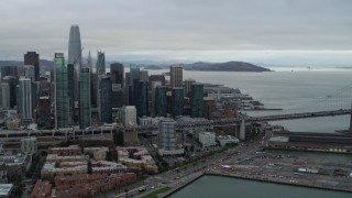 PP0002_000011 - 5.7K stock footage aerial video pan from skyscrapers in city's skyline to Bay Bridge, Downtown San Francisco, California