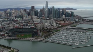 PP0002_000018 - 5.7K stock footage aerial video flyby AT&T Park and marina, with city skyline in background, Downtown San Francisco, California