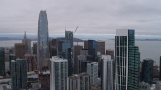 PP0002_000025 - 5.7K stock footage aerial video pan from Bay Bridge to reveal skyscrapers in Downtown San Francisco, California