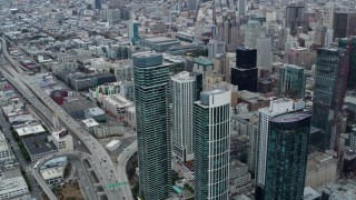 PP0002_000044 - 5.7K stock footage aerial video tilt from Bay Bridge to reveal skyscrapers and the expanse of the city, Downtown San Francisco, California