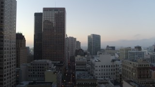 PP0002_000048 - 5.7K stock footage aerial video ascend for view of skyscrapers at sunrise in Downtown San Francisco, California