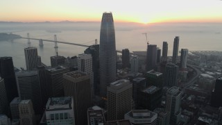 PP0002_000056 - 5.7K stock footage aerial video fly away from Salesforce Tower and skyscrapers at sunrise in Downtown San Francisco, California