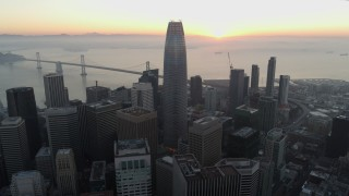 PP0002_000057 - 5.7K stock footage aerial video fly away from Salesforce Tower at sunrise in Downtown San Francisco, California
