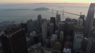PP0002_000060 - 5.7K stock footage aerial video pan from Transamerica Pyramid to reveal Salesforce Tower at sunrise in Downtown San Francisco, California