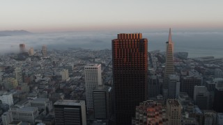 PP0002_000071 - 5.7K stock footage aerial video of fog over the bay behind city skyscrapers in Downtown San Francisco, California