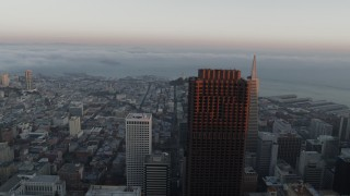 PP0002_000072 - 5.7K stock footage aerial video pan across fog over the bay behind city skyscrapers, reveal Salesforce Tower in Downtown San Francisco, California