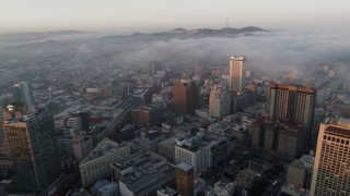 PP0002_000075 - 5.7K stock footage aerial video of fog rolling over Civic Center near office buildings at sunrise in San Francisco, California
