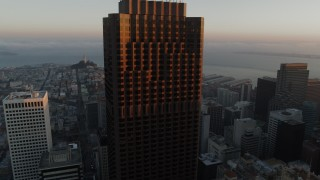 PP0002_000080 - 5.7K stock footage aerial video descend and pan across skyscrapers at sunrise, Downtown San Francisco, California