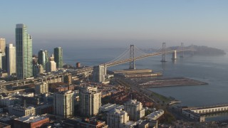 PP0002_000087 - 5.7K stock footage aerial video pan from the Bay Bridge to reveal skyline of Downtown San Francisco, California