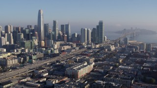 PP0002_000100 - 5.7K stock footage aerial video pan from I-80 in South of Market near city's skyline, reveal Bay Bridge, Downtown San Francisco, California
