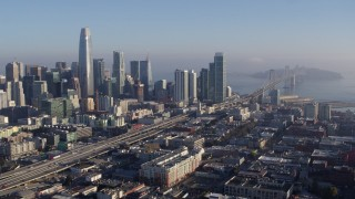 PP0002_000102 - 5.7K stock footage aerial video stationary view of I-80 freeway to Bay Bridge near skyline, Downtown San Francisco, California