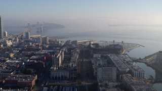 PP0002_000105 - 5.7K stock footage aerial video pan from AT&T Park to reveal I-80 freeway and Bay Bridge near skyline, Downtown San Francisco, California