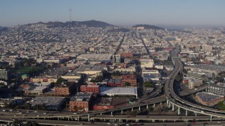 PP0002_000112 - 5.7K stock footage aerial video view across the expanse of the city from freeway interchange, South of Market, San Francisco, California