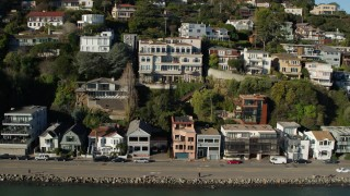 PP0002_000126 - 5.7K stock footage aerial video slowly flying by waterfront homes on a hill by Richardson Bay in Sausalito, California