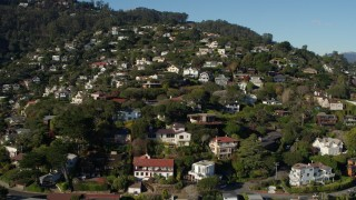 PP0002_000127 - 5.7K stock footage aerial video ascend past homes on a hill for a view of neighborhoods at the top in Sausalito, California