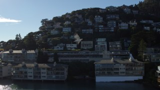 PP0002_000130 - 5.7K stock footage aerial video ascend by waterfront condos to a view of hillside neighborhoods in Sausalito, California
