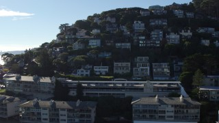 PP0002_000131 - 5.7K stock footage aerial video ascend by waterfront condos to a view hillside homes in Sausalito, California