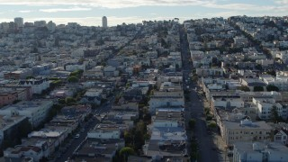 PP0002_000153 - 5.7K stock footage aerial video reverse view of quiet city street lined with apartment buildings in the Marina District, San Francisco, California