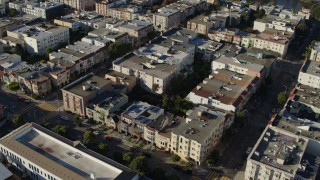 PP0002_000163 - 5.7K stock footage aerial video approach row of apartment buildings and tilt to bird's eye view, Marina District, San Francisco, California
