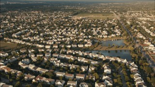PP001_004 - HD aerial stock footage video of flying over suburban neighborhoods at sunset in Joliet, Illinois