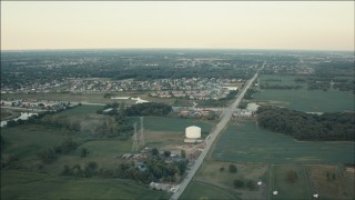 PP001_009 - HD stock footage aerial video fly over farmland to approach homes at sunset in Homer Glen, Illinois