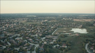 PP001_010 - HD stock footage aerial video of flying over suburban neighborhoods at sunset in Orland Park, Illinois