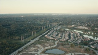 PP001_011 - HD stock footage aerial video of suburban homes and rows of power lines at sunset, Orland Park, Illinois