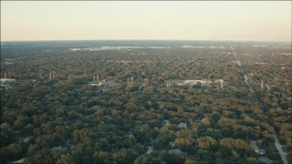 PP001_013 - HD stock footage aerial video of suburban neighborhoods and trees at sunset in Palos Heights, Illinois