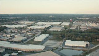 PP001_015 - HD stock footage aerial video of flying over large warehouse buildings at sunset, Alsip, Illinois