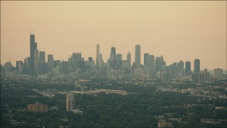 PP001_016 - HD stock footage aerial video of the hazy skyline at sunset in Downtown Chicago, Illinois