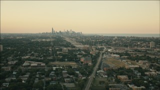 PP001_017 - HD stock footage aerial video of the Downtown Chicago skyline at sunset seen from Englewood, Illinois