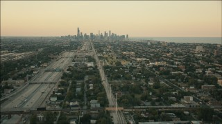 PP001_019 - HD stock footage aerial video of the city skyline at sunset seen from freeway on South Side, Downtown Chicago, Illinois